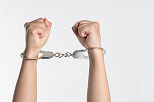 A pair of hands in handcuffs | Criminal Law | Her Lawyer