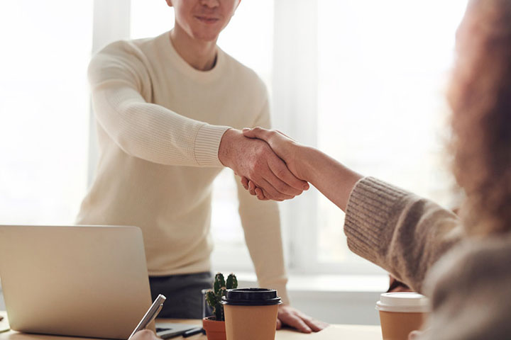 Attorney and client shake hands | Her Lawyer